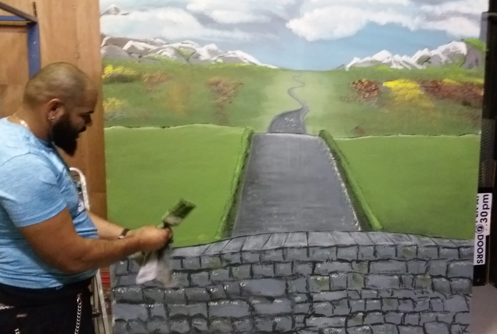 Rodney Connors painting a fairytale setting